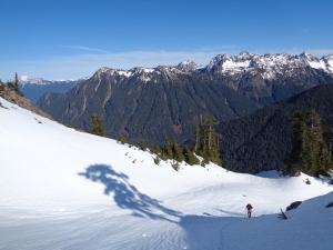 Surafel descending with Pugh (left), Glacier (back center), Sheep (foreground), Monte Cristo (right)