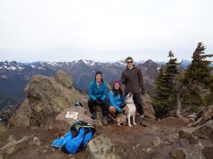 Three hikers and a happy dog (true summit)
