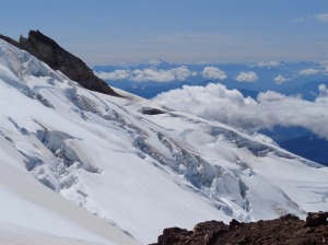 Glacier Peak beyond crevasses on the Deming glacier