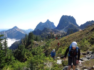 Looking back at everyone approaching the talus field, Townsend and Merchant in the background